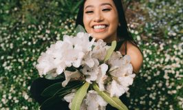 girl smiling with a bouquet of flowers